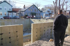 Craig Thomas, City of Lowell Urban Renewal Project Manager, views the work site.
