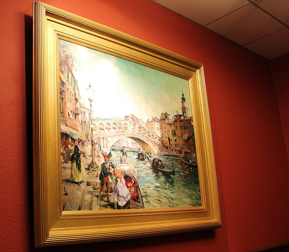 "The restored ""Venezia"" by Lowell artist David Neal hanging on the ground floor landing of the grand staircase."