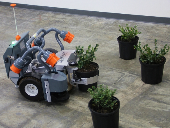 This robot by Harvest Automation of Billerica moves and spaces potted plants in greenhouses.