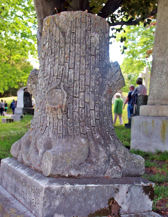 "A granite tree stump grave marker. The stump symbolizes a life ""cut down""."