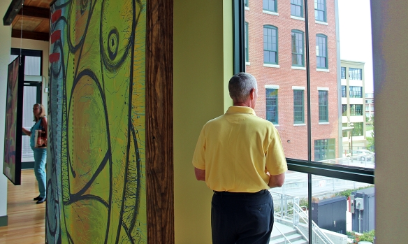 Erving Town Administrator Tom sharp checks out the view from Appleton Mills.
