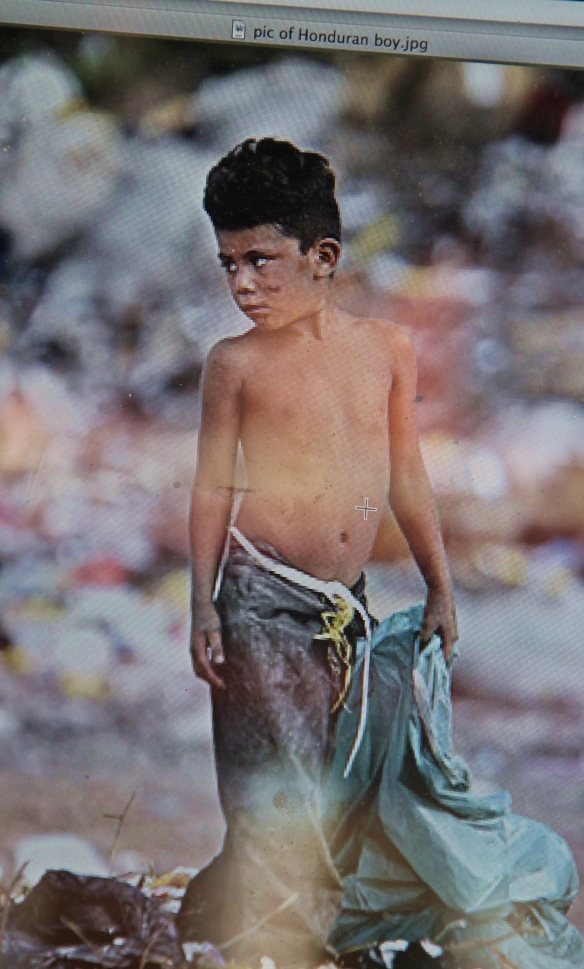 The piece Oscar-Alberto Bogran was painting on Market Street Friday is based on this photo of a poverty-stricken boy in Honduras, the country where Oscar was born.