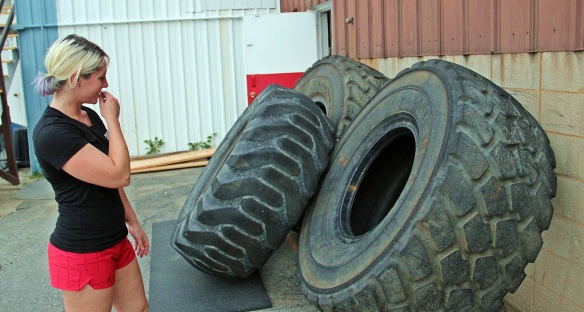 "The big tires weigh 800 pounds, the ""smaller"" tire weighs 650 pounds. Yes, the CrossFitters flip these over."