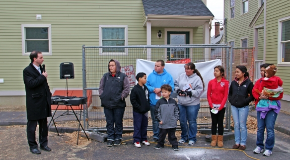 Mayor Patrick Murphy congratulates the Medeiros and Pol families as they move into their new homes.
