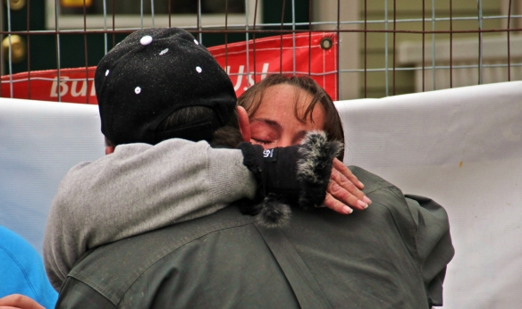 Sandra Medeiros hugs Habitat for Humanity Construction Manager Scott Carpenter.