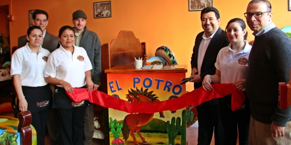 Assistant City Manager Adam Baacke and Mayor Patrick Murphy join El Potro's staff, including owner Elias Interiano and Business Manager Joe Carreiro in officially cutting the ribbon.